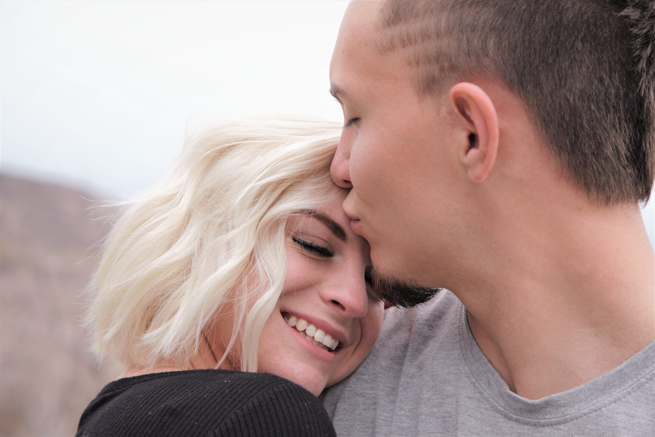 Image of Man kissing on his girl head