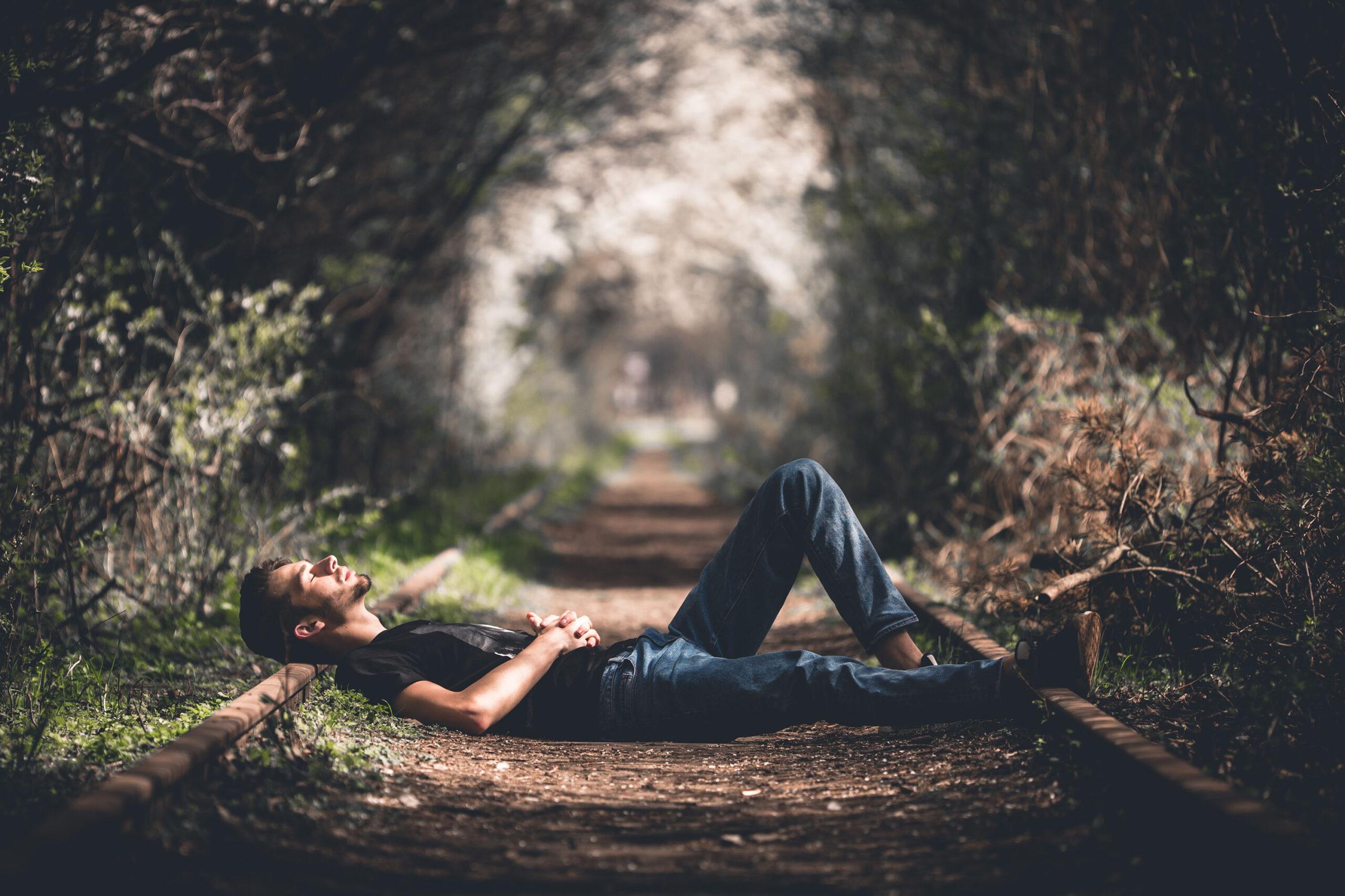 Man Sleeping on Road