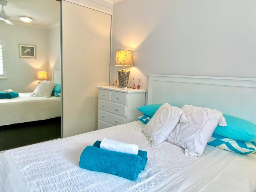 Picture of bedroom with side table lamp and mirror