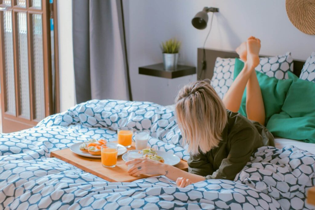 Picture of Women doing breakfast on bed - Healthy Living Lifestyle