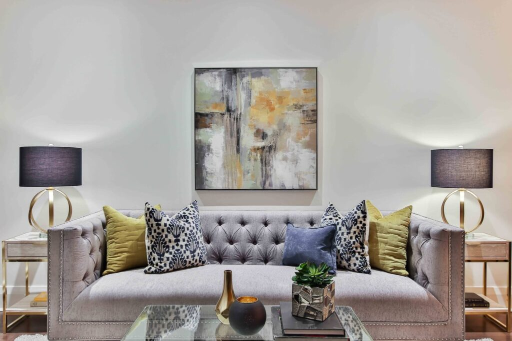 Picture of pillows on Sofa with wall