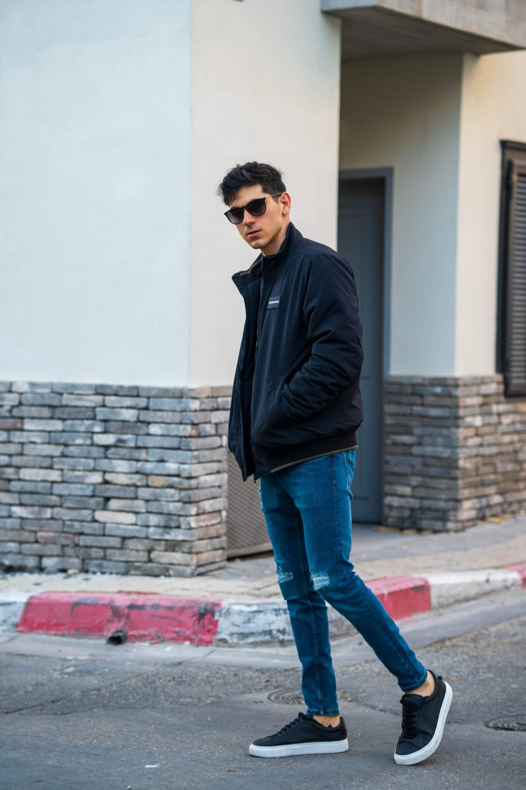 Handsome Young Guy Elad Michaeli in Jeans and Sneaker